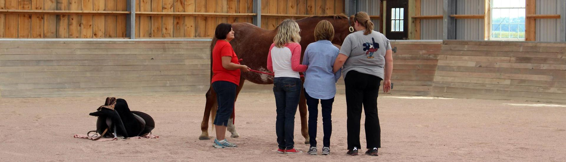 Women in Arena with Horse