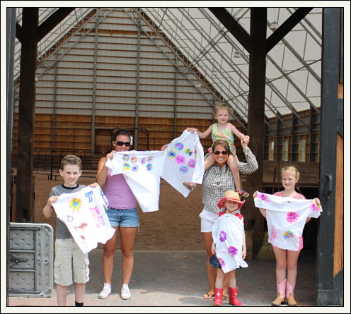 Kids showing t-shirts in barn