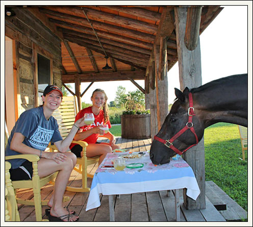 Horse and girls eating at table